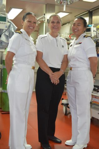 Professor Kristine Qureshi smiles with service members