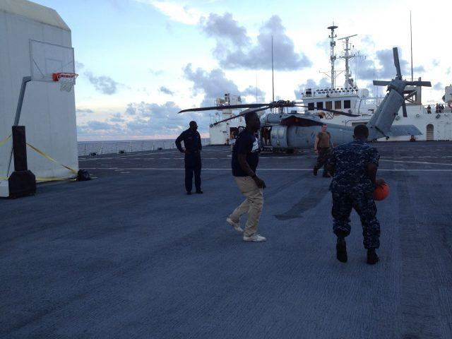 Pick-up basketball game between Navy and NGO volunteers on board ship