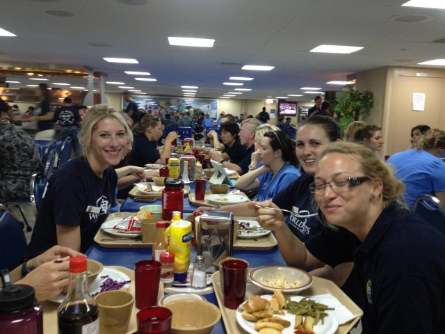 """Monique sharing dinner and laughs with a duo from the """"World Vets"""" NGO group"""