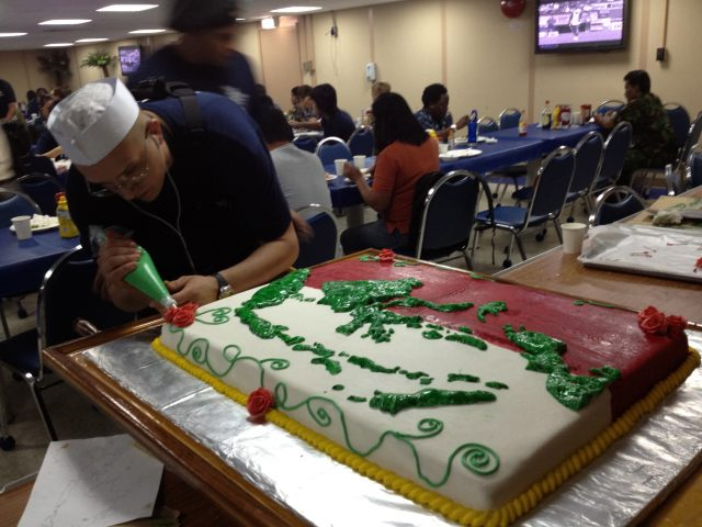 The culinary staff prepares for PP12 Indonesia opening day festivities with an incredible cake.