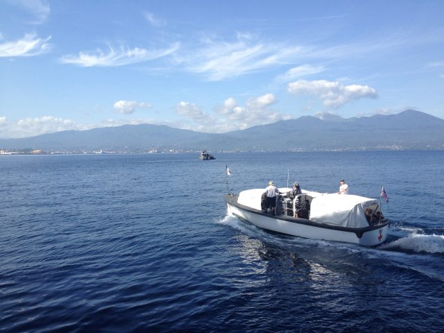 """photo of The tiny """"Band-Aid"""" boat is how people get back and forth to shore from the USNS Mercy."""