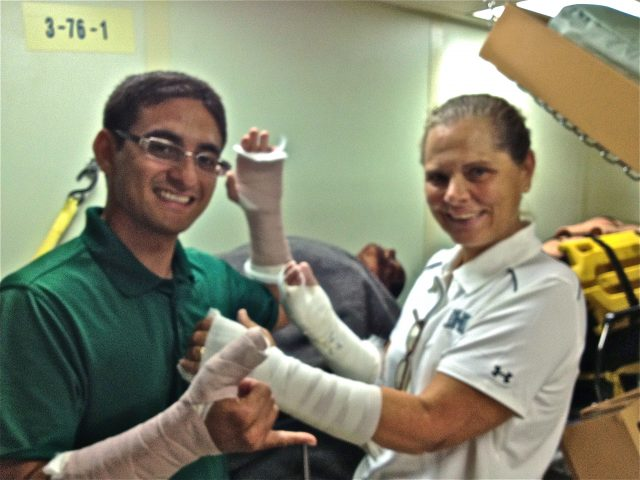 Pacific Partnership 2012 SMEE team practices bandaging
