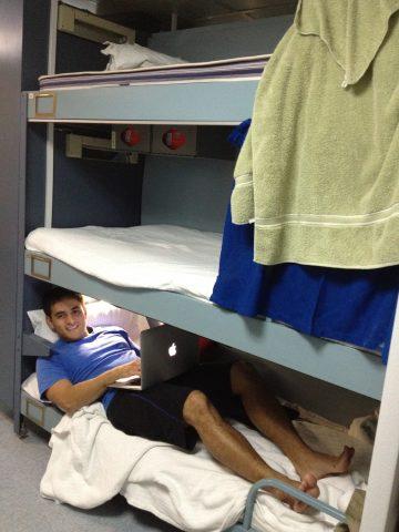 student enjoys bunk on ship