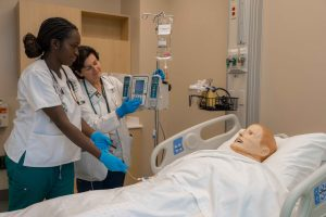 graduate entry program in nursing student and faculty in simulation lab