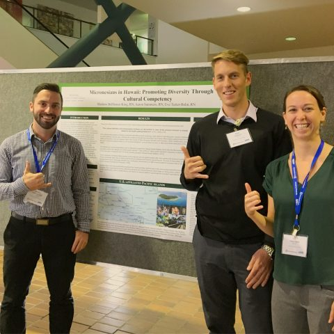 Representatives of the American Assembly for Men in Nursing at University of Hawaii present poster