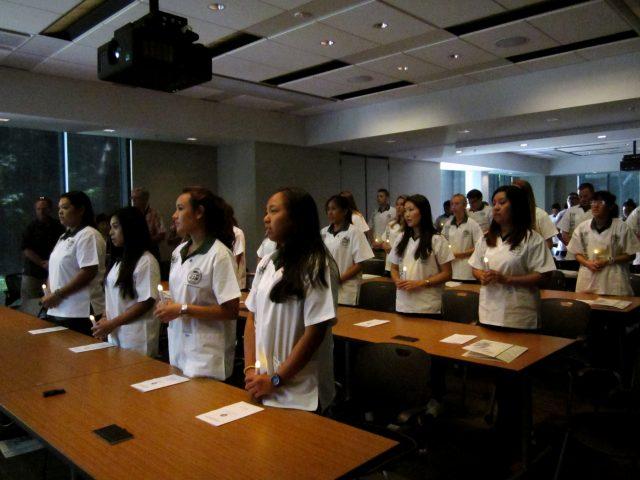 students pledge at white coat ceremony