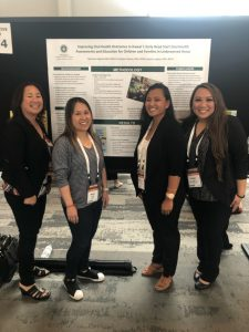 dental hygiene students present at a conference