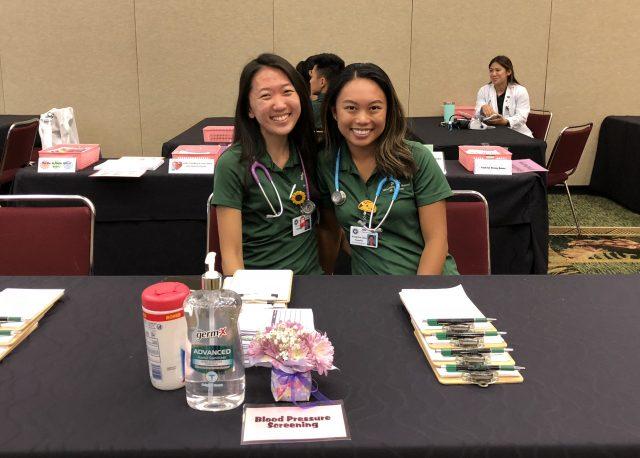 student nurses vounteering at the okinawan festival