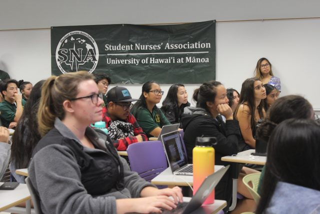 students attend educational lecture about critical care nursing