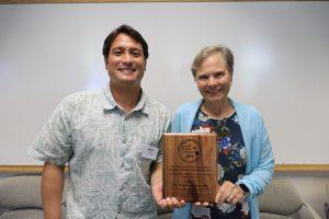 Scott presents Qureshi with award