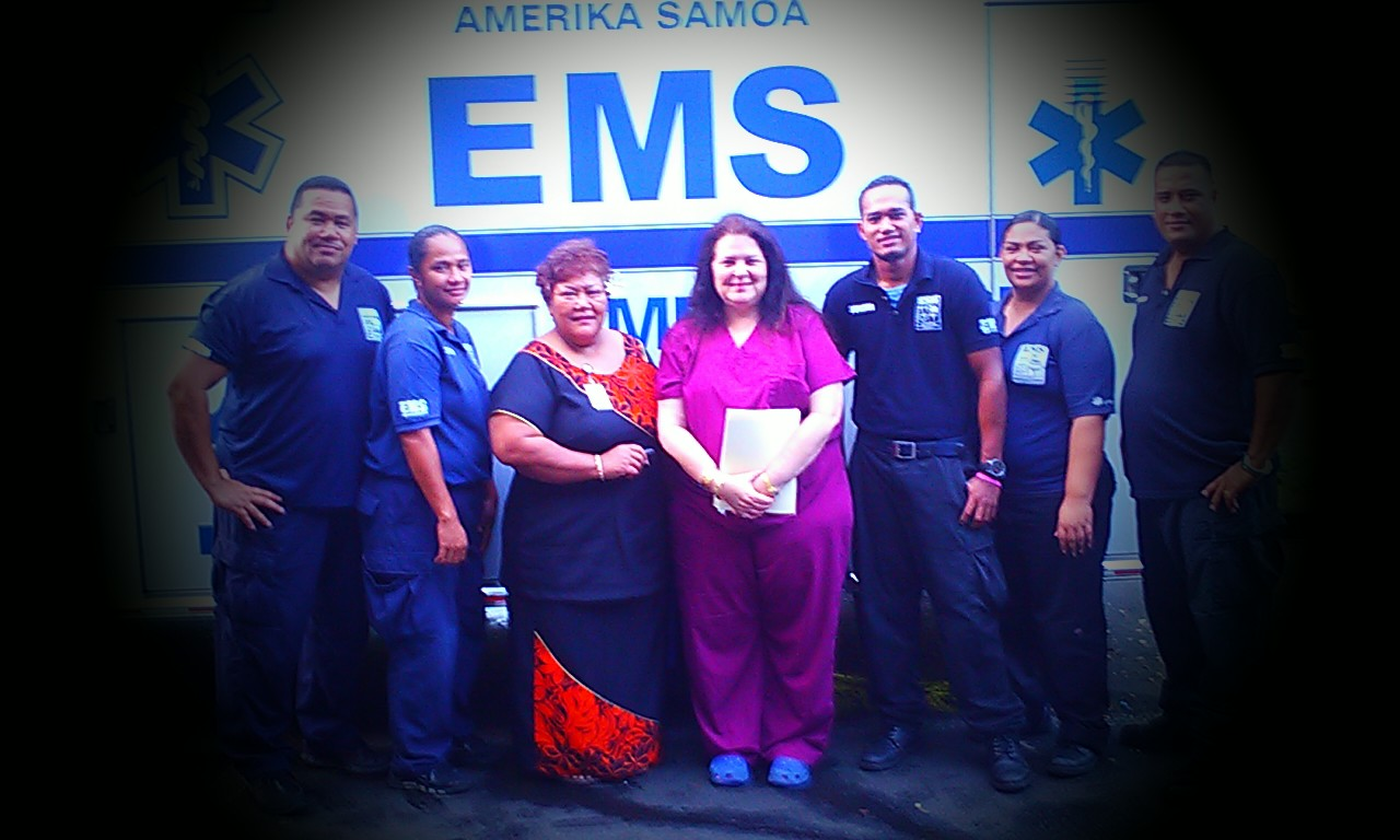 Trankel poses with ems team