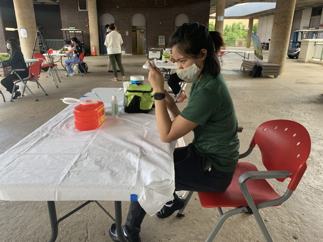 Nursing student drawing up an artificial vaccine