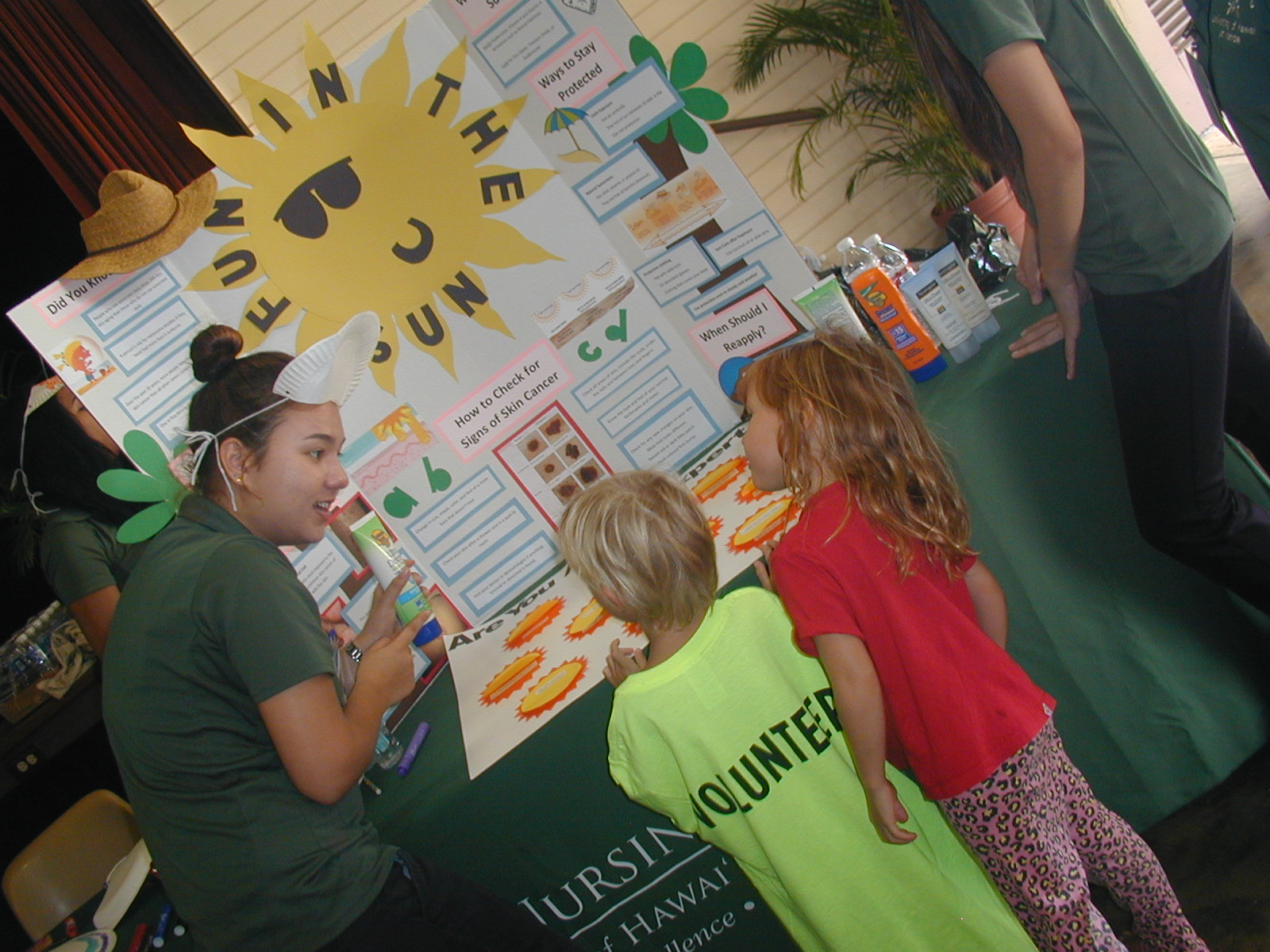 students interact with keiki on YMCA Healthy Kids Day