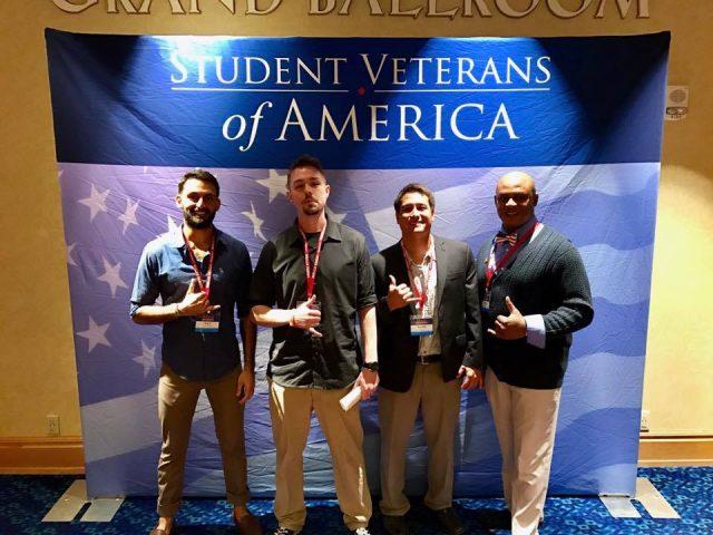 student veterans pose