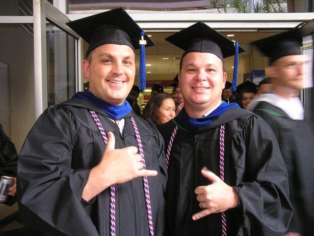 UH Manoa veteran graduates smile for photo