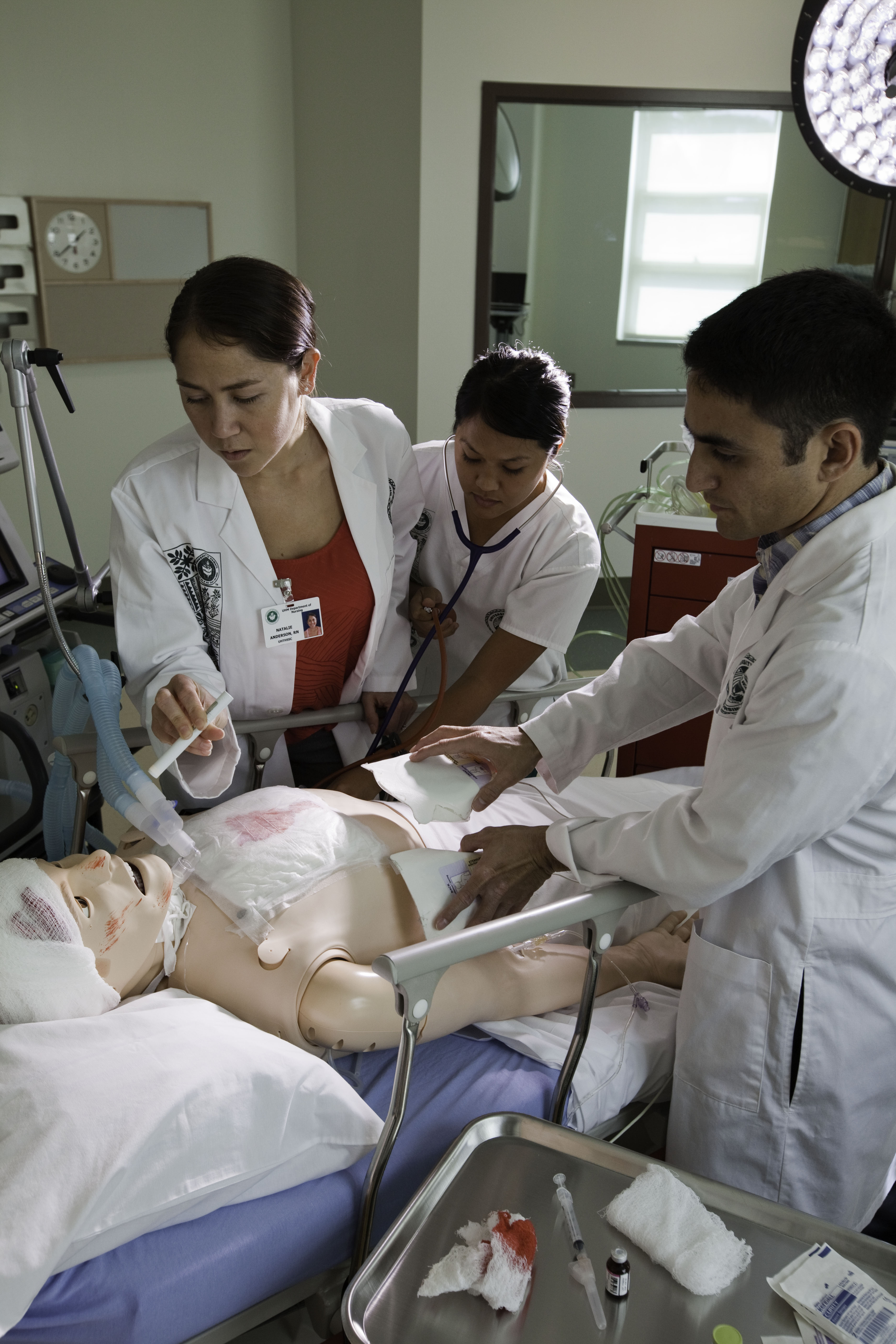 Dr. Lorrie Wong participates with students assisting dummy patient
