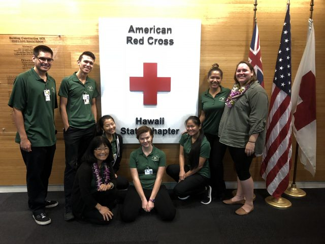 students work with red cross