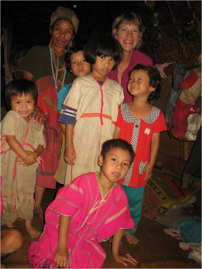 Sharon Jensen smiles around thai children