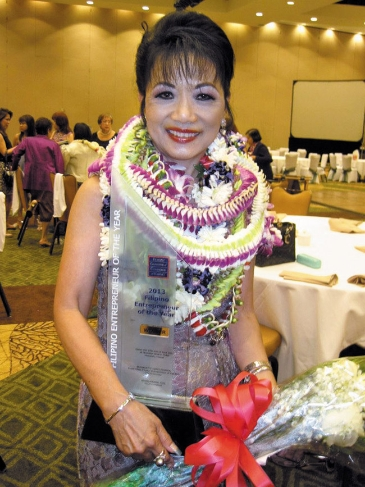 Nancy Atmospera-Walch smiles for photo after receiving award