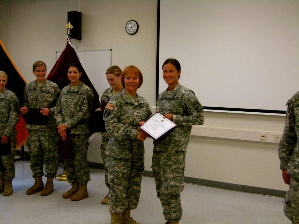 Cadet Wei Burkes accepts award